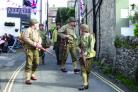 Men dressed in 1940s military clothing have a chat by a Spitfire on display at Grassington's 1940s weekend.