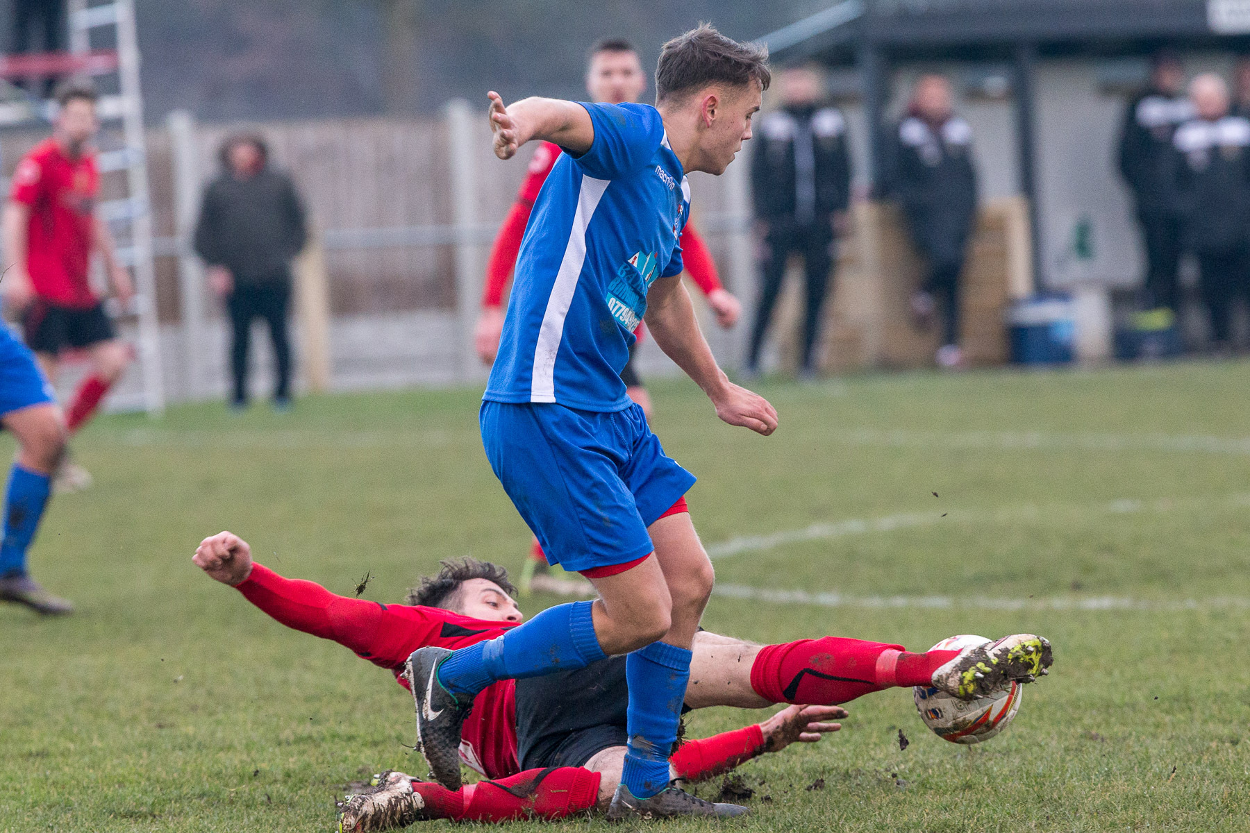 Craig Bentham tackles Alport's Nicholas Marley as Silsden kept up their record of avoiding postponements last Saturday when six other games in their division were called off     Picture: David Brett