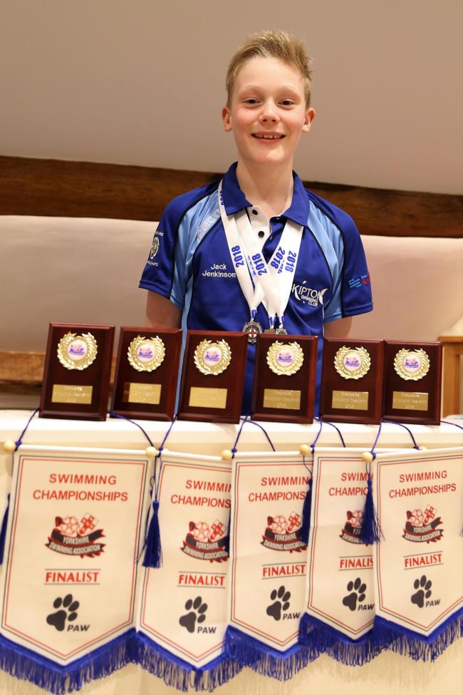 Jack Jenkinson shows off his medal haul