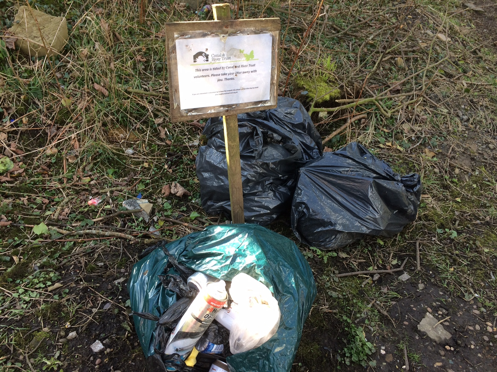 Bags of dropped litter by the Leeds and Liverpool Canal