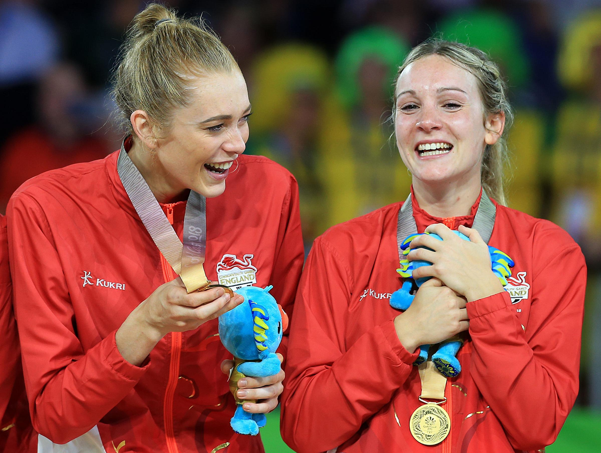 Helen Housby and Natalie Haythornthwaite (right) celebrate with their gold medals. Picture by Martin Rickett/PA Wire