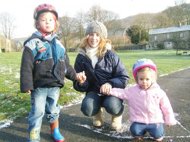 Novelist Marina Fiorato on Langcliffe Village Green with her children