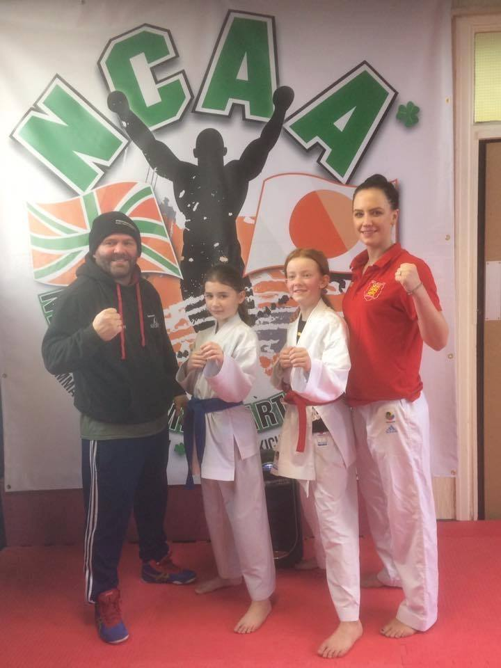 Paul Newby, his partner Siobhan Hayes, and two members of his martial arts class
