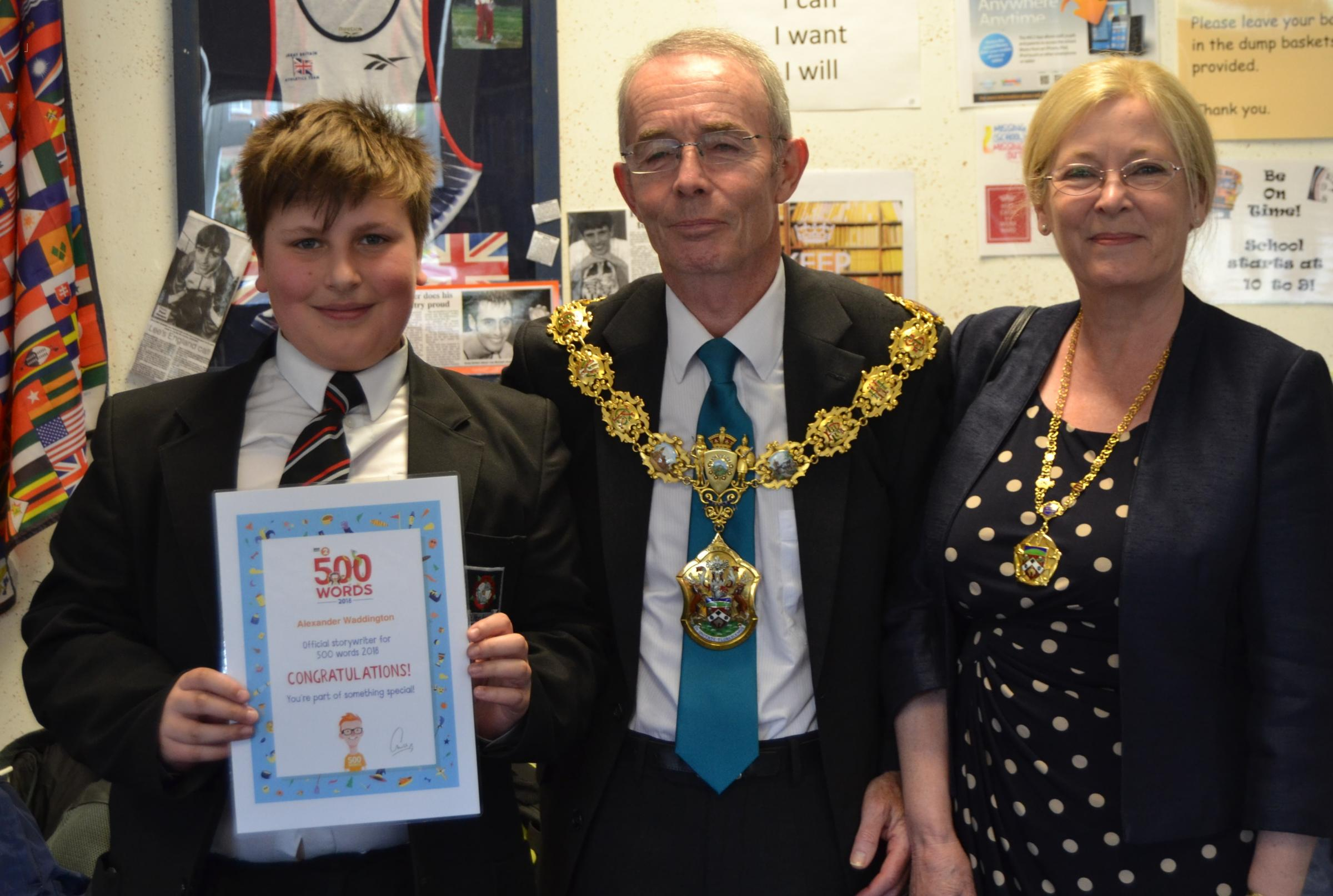 West Craven High School student Alexander Waddington has made it to finals day of the BBC Radio 2 500 Words competition, He is pictured with former Pendle mayor, Councillor David Whalley, the former mayoress, Barbara Whalley