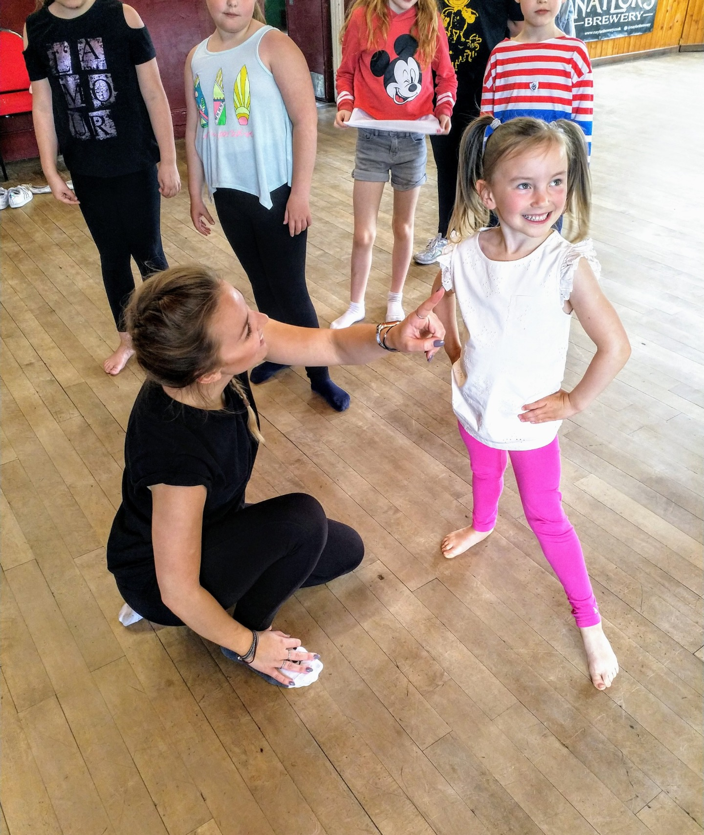Gemma Pipe works with one of the children at the West End musical theatre workshop in Glusburn
