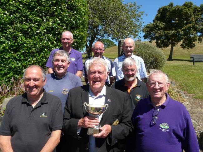 The Skipton and District Veterans' Handicap Final sponsor Roy Sanderson, middle front, lines up with the seven finalists at Silsden Playing Fields