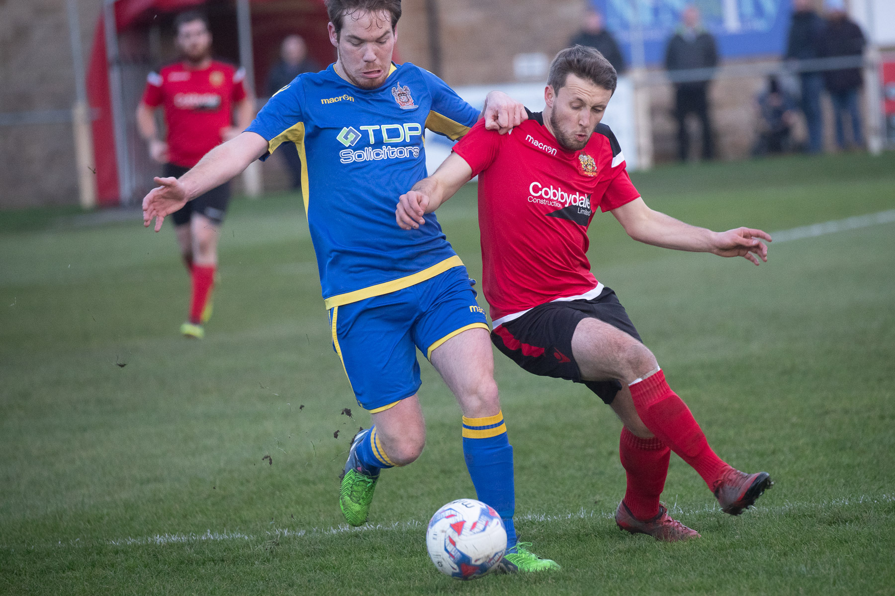 Bootle's Ben Jago battles for the ball with Silsden's Chris Wademan, right, during the latter side's 7-0 defeat in Hallmark Security League Premier Division. Picture: David Brett