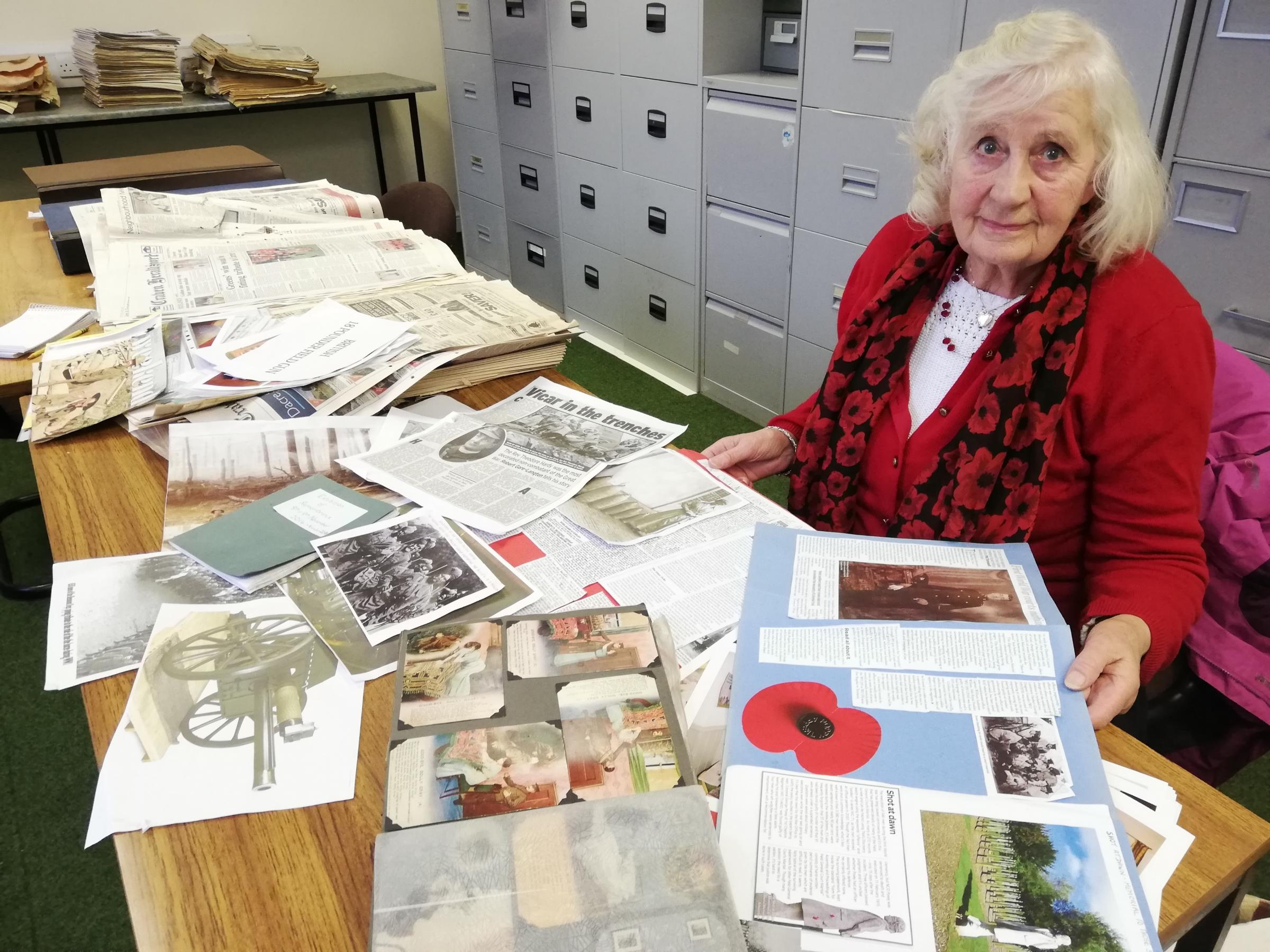 Muriel Hargraves with some of the research used for the Armistice exhibition in Hebden Village Institute