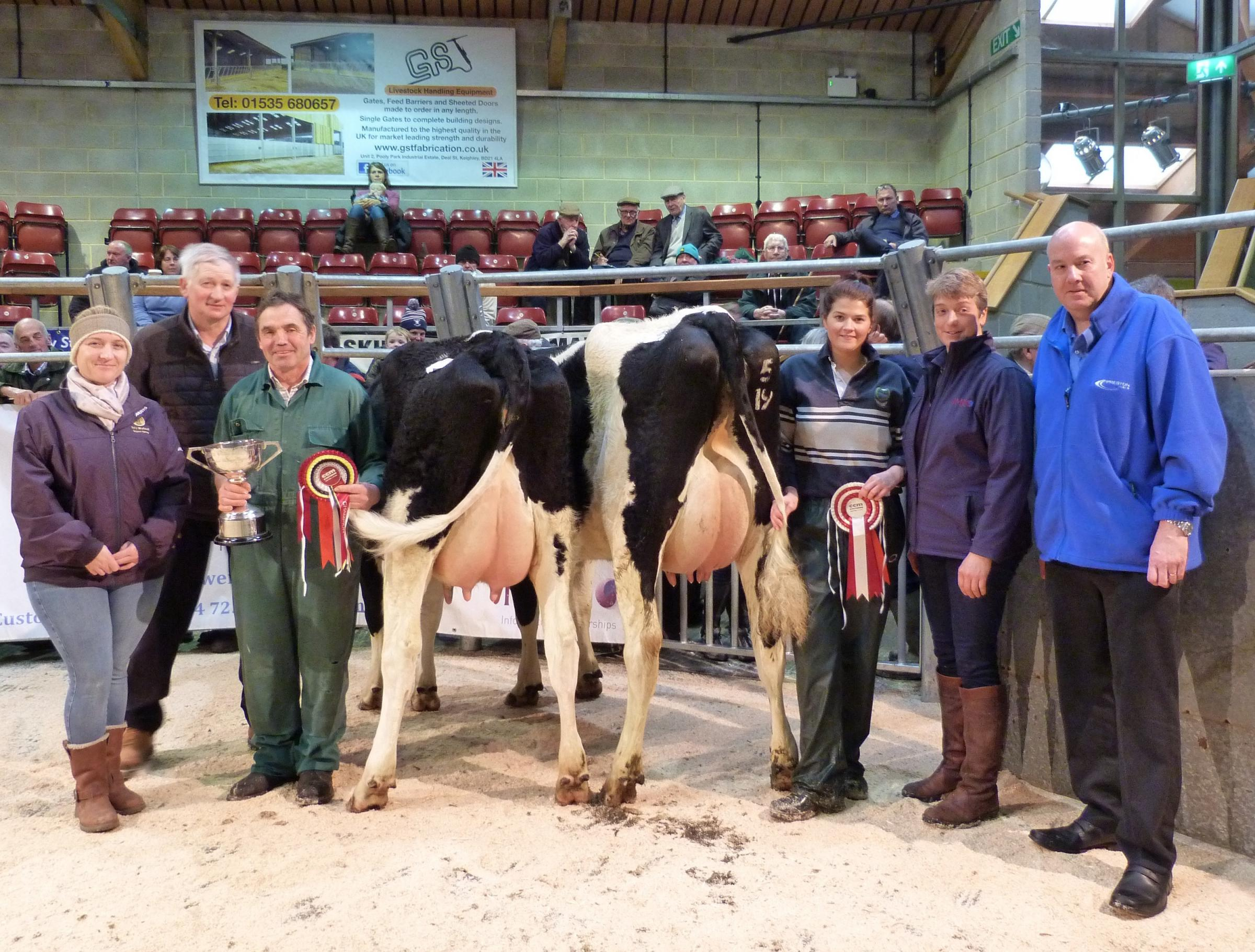 left to right) Claire Radley, of NFU Skipton, judge Allan Throup, Brian Moorhouse with his supreme champion, Suzy Lawson with the reserve champion, and sponsors Helen Whittaker, of National Milk Records, and Mike Thompson of Preston Fuels, Halifax