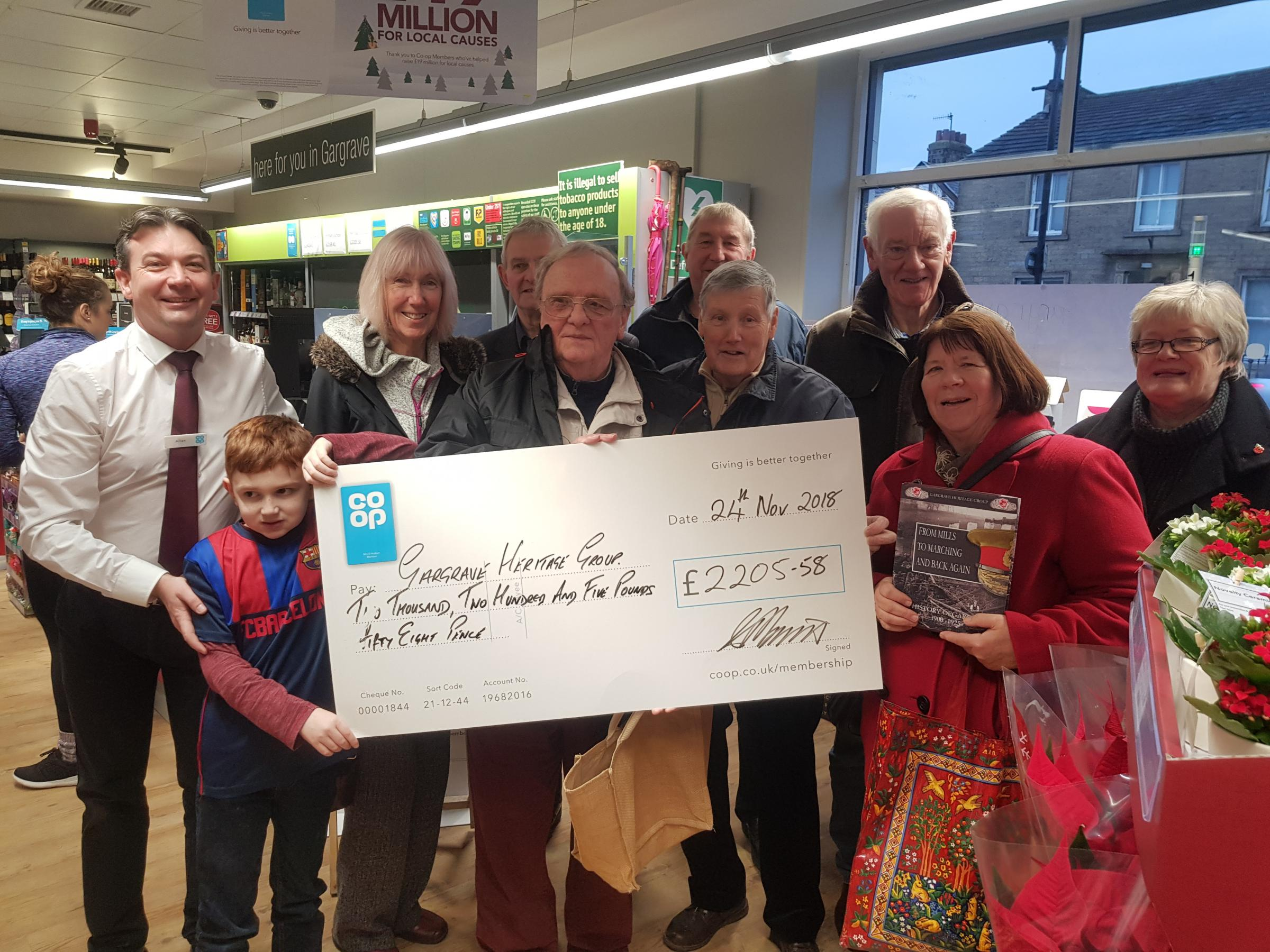 MEMBERS of the Gargrave Heritage Group are presented with a cheque for £2,205.58 by Allan Morris, the manager of the Gargrave branch of the Co-op