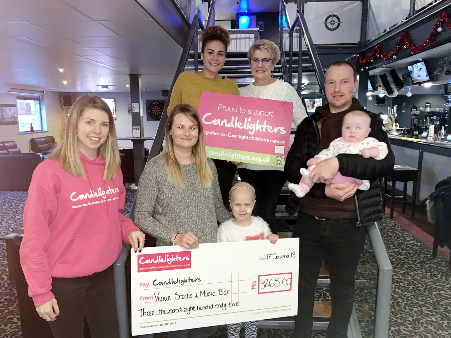 Pictured at Venue Sports and Music Bar are representatives of the family, Candlelighters and charity event organisers – from left, Gina Trotter, Leah Pompey, Sharron Pompey, Rachel Hodgkiss, Maddie Jameson, Liam Jameson and Amy Jameson.