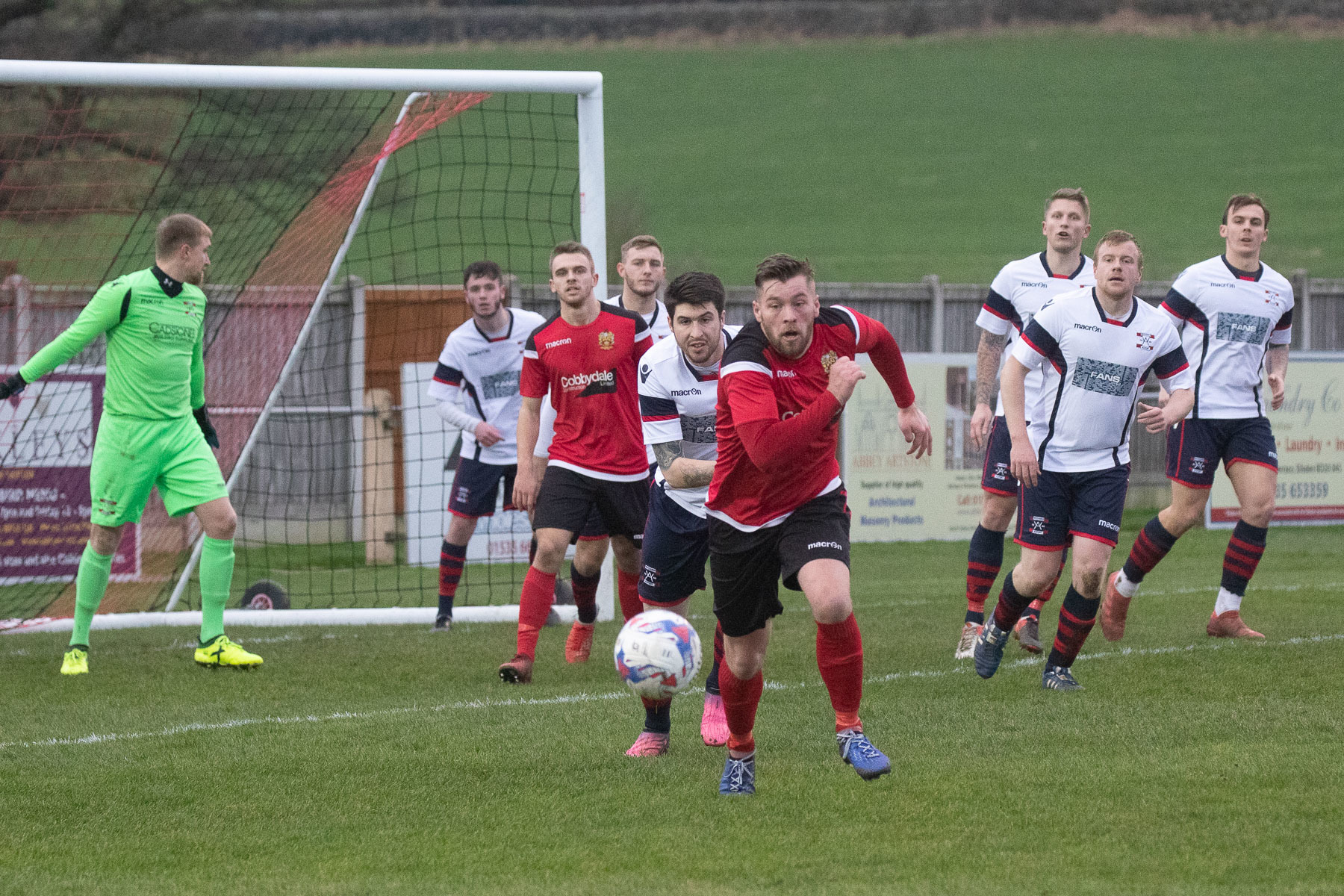 Aidan Kirby, centre, was the hero for Silsden, scoring the winner in a 4-3 win at Squires Gate. Picture: David Brett
