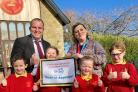 Head teacher Richard Wright, with assistant head Amanda Allen and pupils at Kirkby Malham Primary School