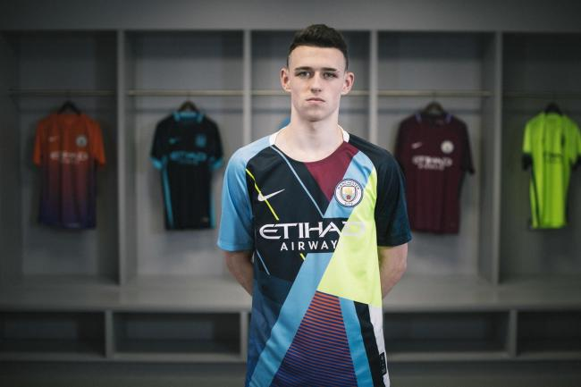 709fabbe7a1 Manchester City midfielder Phil Foden models the club's new celebration  shirt