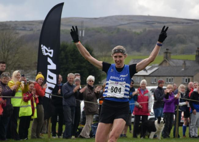 Victoria Wilkinson crosses the finish line in a previous year's Three Peaks race. Picture: Dave Woodhead