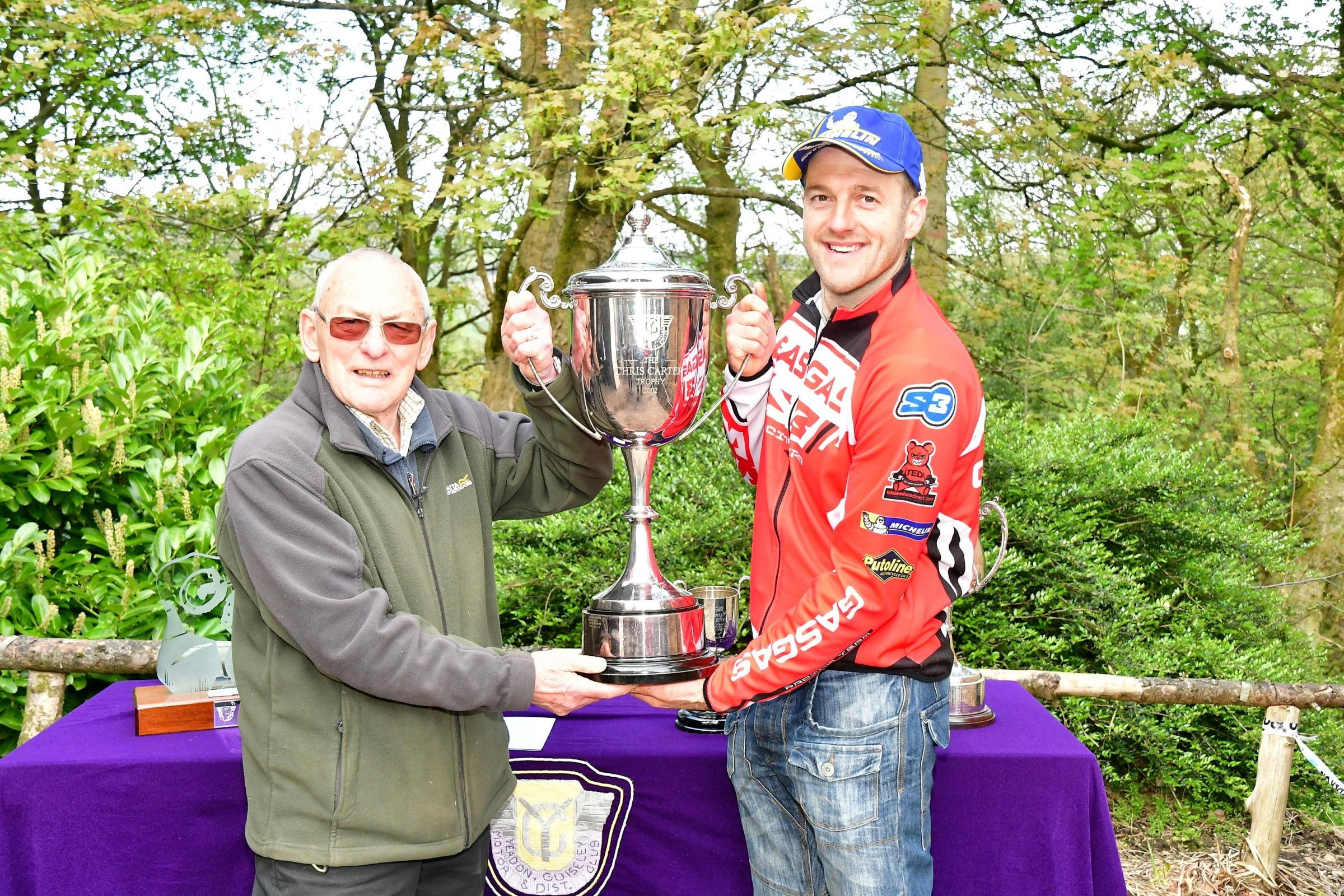Mike Hinch presents the Chris Carter Trophy to Dan Thorpe, who won a trial at Dob Park on Sunday. Picture: Barry Robinson