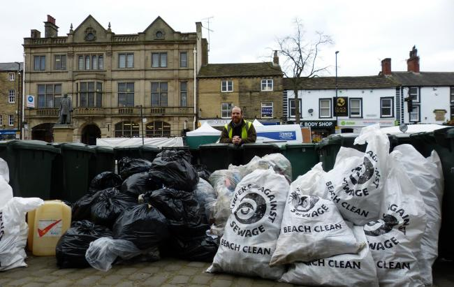 Wayne Gray, environmental health officer, with litter collected in recent spring clean