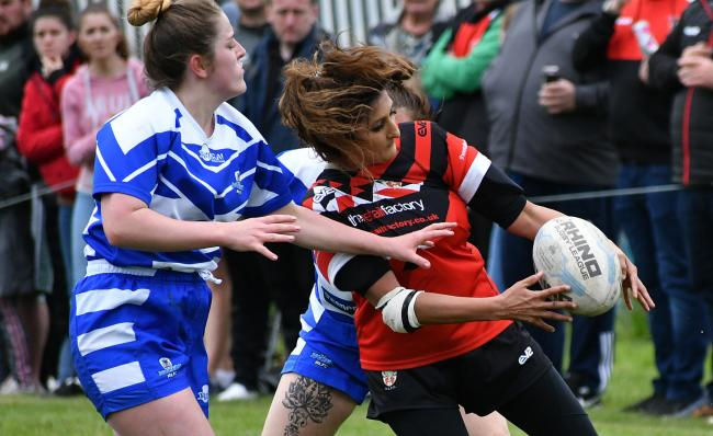 Saima Hussain grasps the ball for Keighley Albion Ladies in their 50-9 Challenge Cup second round win over Halifax last month. Picture: Richard Leach