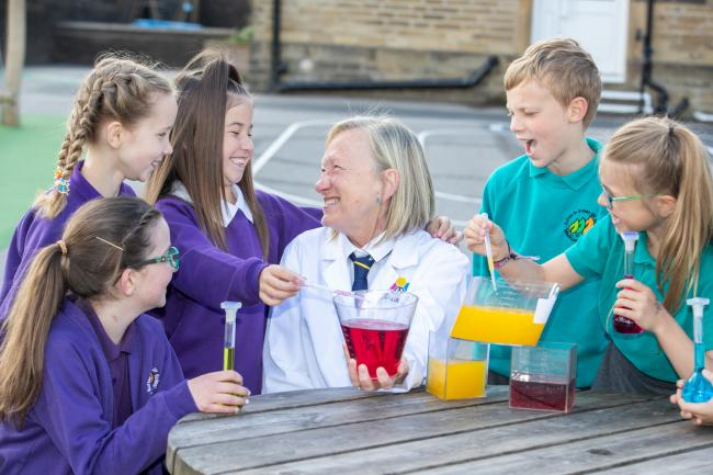 Madeleine Lofthouse, of Airedale Chemical, with year-four pupils at Sutton Community Primary School
